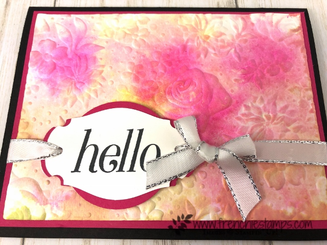 Watercolor with the Country Floral Embossing folder. The folder is limited edition during sale a bration and can be yours for free with qualified order at frenchiestamps.com. Punch limited edition the Story Label. Stamp set Floral Frames.